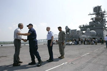 President George W. Bush is greeted by U.S. Coast Guard