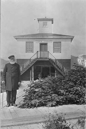 Father William Duncan in front of town library